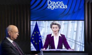 Klaus Schwab, founder of the World Economic Forum, listens as Ursula von der Leyen speaks