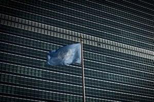 The UN flag flies in front of the secretariat building