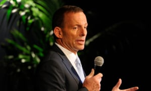 Tony Abbott speaking into a microphone.