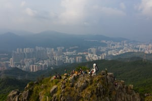 The Lady Liberty statue is seen on the peak of Lion Rock in Hong Kong.
