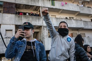 Young Neapolitans  cheer for the demolition of the notorious Le Vele di Scampia housing estate
