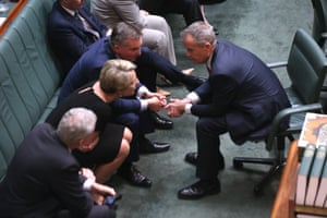 Bill Shorten confers with his front bench