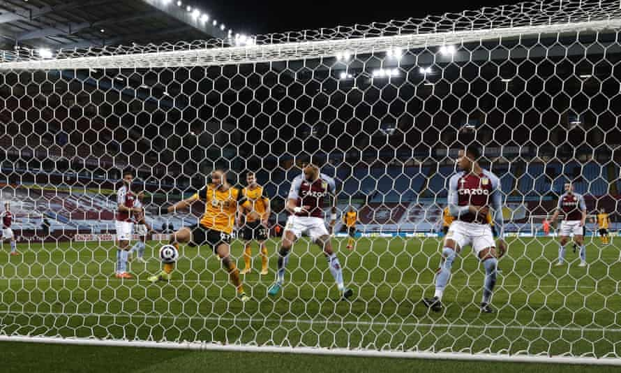 Romain Saïss of Wolves somehow scoops this incredible chance over the crossbar to let Aston Villa off the hook for their own profligacy.