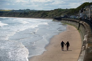 May 2020: Mark Allitt and his partner, Sarah Mason, an NHS medical receptionist, walk hand in hand on the beach at Filey