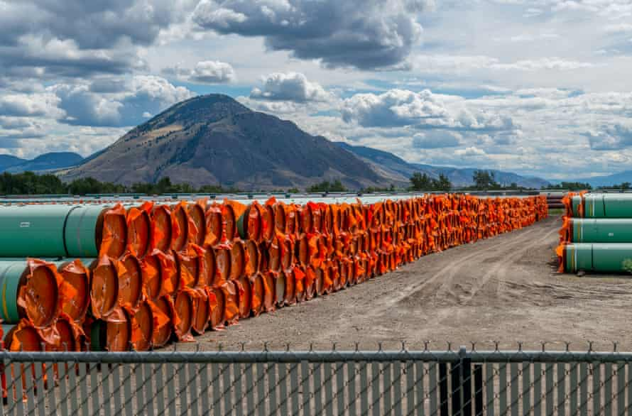 Steel pipe to be used in the oil pipeline construction of the Trans Mountain expansion project lies at a stockpile site in Kamloops, British Columbia, Canada, in June.