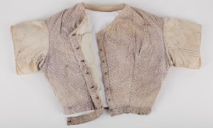 Bodice made of purple, floral printed cotton and calicoExcavated from underfloor at Hyde Park Barracks. Historical period of Hyde Park Barracks: Hyde Park Asylum for Infirm and Destitute Women 1862–1886 Lady's bodice, purple floral printed cotton, heavy calico sleeves, lined with calico to form jacket. Metal eyes and hooks. Handsewn. HPA laundry stamp on rear of bodice. Details available in the Vernon Collection Database. Refer to the Registrar, Collections & Access.