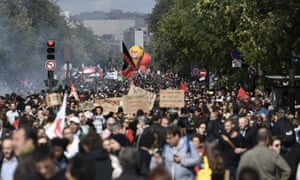 Demonstrators take part in a protest called by several French unions against the labour law reform in Paris.