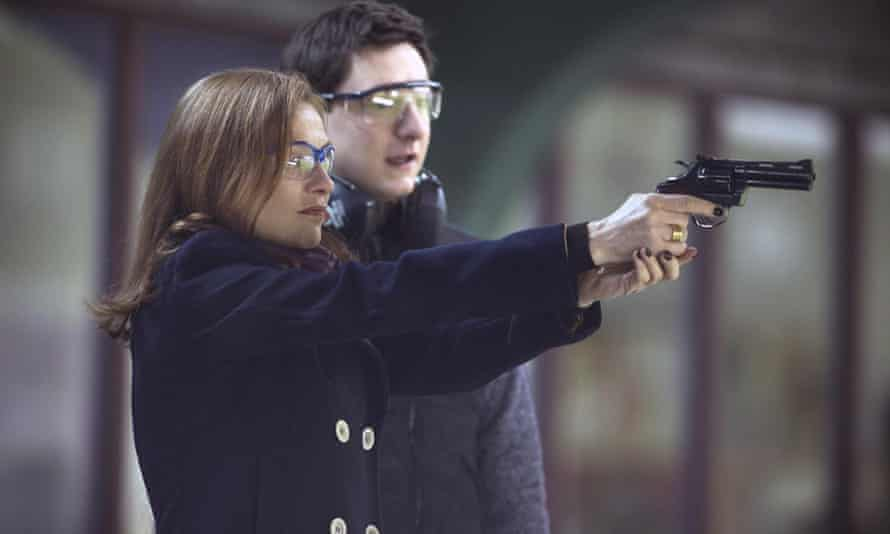 Isabelle Huppert on the gun range in Elle