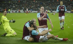 West Ham players celebrate Andy Carroll's dramatic late winner at the London Stadium.