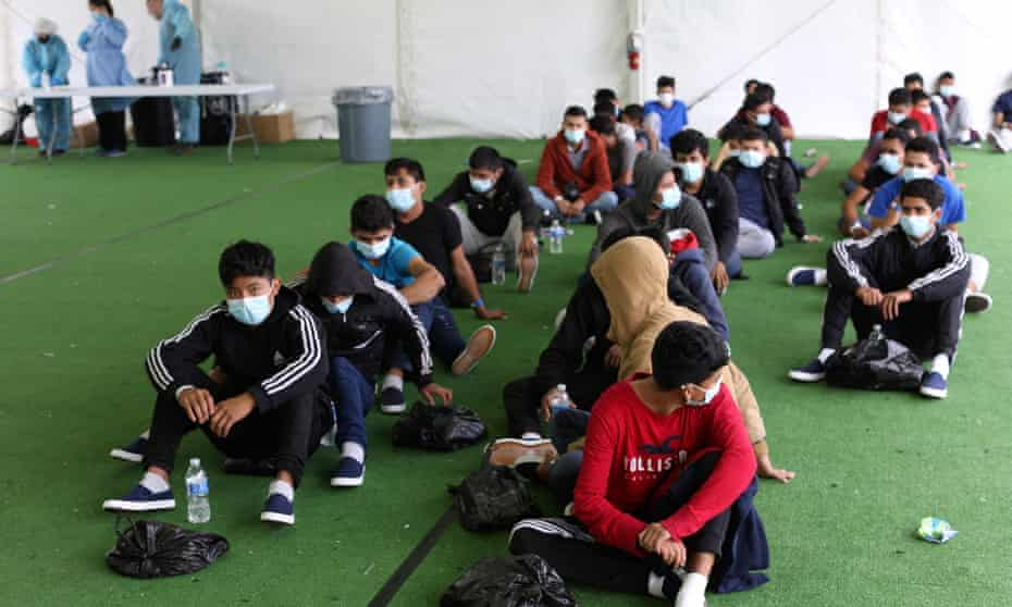 US-TEXAS-BORDER-IMMIGRATION-DETENTIONYoung migrants wait to be tested for Covid-19 at the Donna facility in the Rio Grande Valley in Donna, Texas on 30 March 2021.
