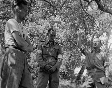 British army chaplain the Rev Leslie Skinner (right) conducts a funeral for a serviceman in a British forward area of Normandy during the second world war, 14 August 1944