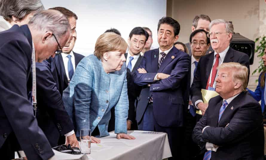 Angela Merkel speaks to Donald Trump at the G7 summit in Canada in June.