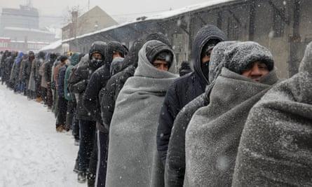People wait for food in Belgrade, Serbia, 2017.