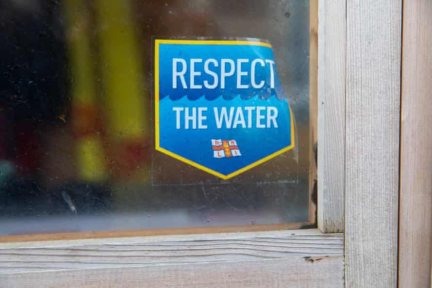 A sticker saying 'Respect The Water'.