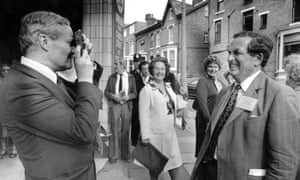 Tony Benn, left, takes a picture of Denis Healey