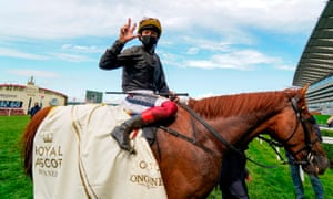 Frankie Dettori celebrates holding up three fingers after he and Stradivarius won the Gold Cup in June.