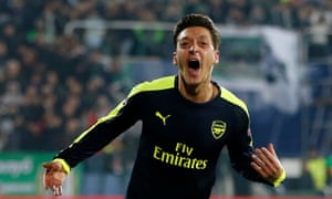 Mesut Ozil celebrates scoring the winner.