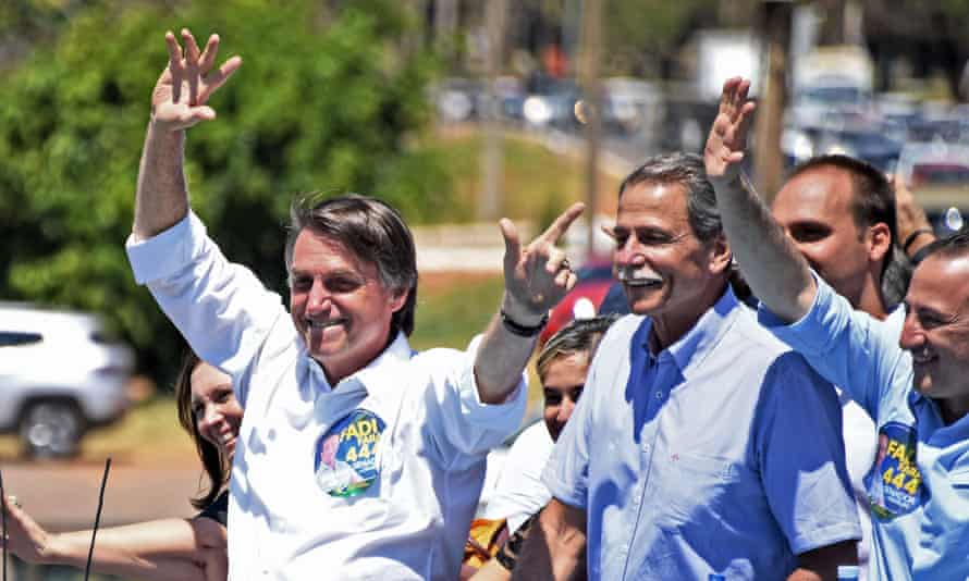 Jair Bolsonaro waves to the crowd