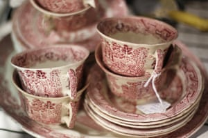 A collection of beautiful red and white antique dishes for sale
