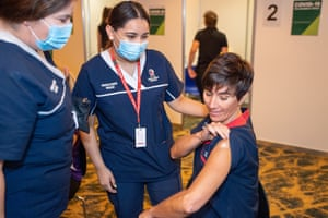 Nurse Antonia Garza (right) shows off her arm after receiving the Pfizer coronavirus vaccine at the Hyatt Perth quarantine hotel last Monday.