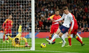 England's Mason Mount pushes the ball into the net, but he is beaten off because he is offside.