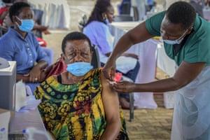 A woman receives a coronavirus vaccination at the Kololo airstrip in Kampala, Uganda, Monday, on 31 May, 2021.