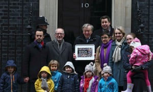 Alf Dubs with protesters at No 10 Downing Street as they opposed the closure of his scheme in February.