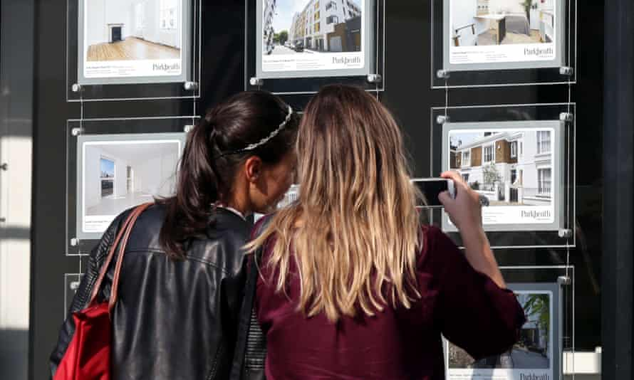 Houses for sale in an estate agent's window