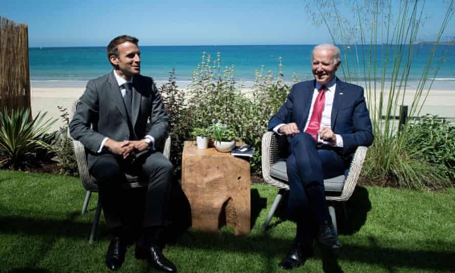 President Emmanuel Macron of France, left and President Joe Biden at the summit.