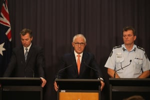 Malcolm Turnbull, Justice Minister Michael Keenan and AFP commissioner Andrew Colvin at a press conference in the blue room.