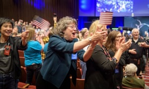 Guests congratulate New Horizons team members after they received signals from the spacecraft