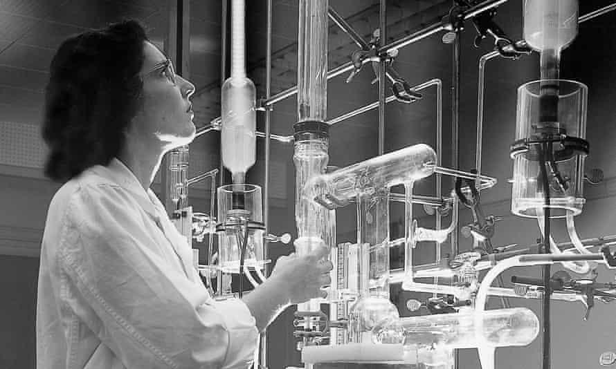 Woman scientist examines her scientific apparatus