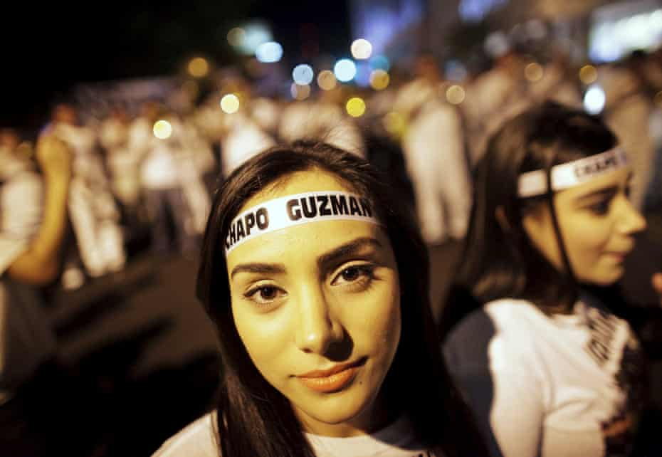 Young women wear headbands featuring the name of El Chapo during a march in Culiacan in February 2014.