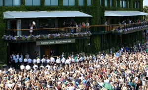 Angelique Kerber emerges on the Centre Court balcony and shows the Venus Rosewater dish to the fans outside.