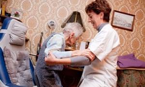 home carer helping elderly client