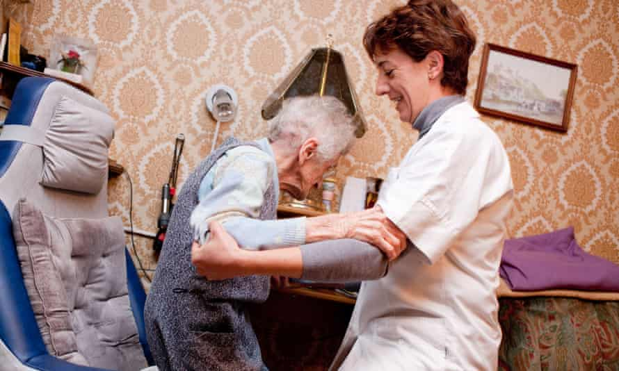 home carer helping elderly client