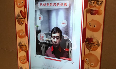 An employee a KFC in Beijing demonstrates the facial recognition ordering machine.