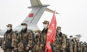 Chinese military medical staff arrive in Wuhan as the coronavirus death toll passes the Sars epidemic fatalities.