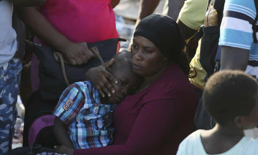 A woman conforts her son as they wait to be evacuated to Nassau at the port in Marsh Harbor, Abaco Island, Bahamas, on Saturday.