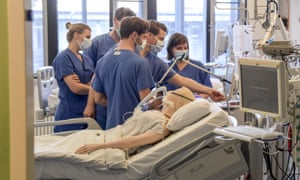 Doctors get instructions on a ventilator at the University Hospital Eppendorf in Hamburg Germany.