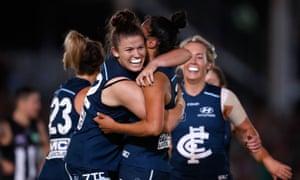 Bella Ayre of Carlton (left) congratulates team-mate Darcy Vescio