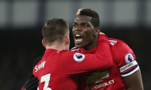 Paul Pogba celebrates with Luke Shaw after setting up Anthony Martial for Manchester United's first goal at Everton