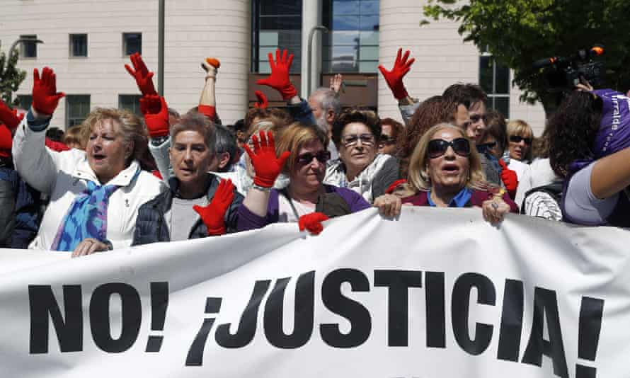 Hundreds of people, many wearing red gloves as a symbol against sexual abuse, protested outside the original sentencing hearing.