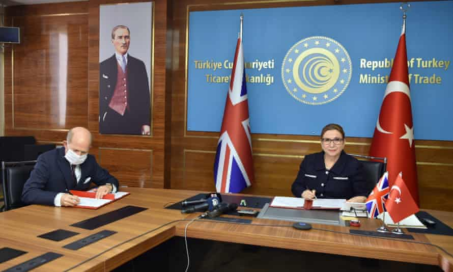 The Turkish trade minister, Ruhsar Pekcan, right, and the UK's ambassador to Turkey, Dominick Chilcott, attend the signing ceremony for a free trade agreement