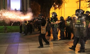 Riot policemen fire teargas during a rally against a Russian lawmaker's visit in Tbilisi.