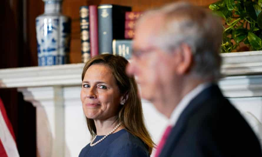 Amy Coney Barrett and Mitch McConnell on Capitol Hill in Washington on 29 September 2020.