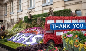 A gardener putting the finishing touches to a floral display thanking the NHS and key workers outside Birmingham city council house today.