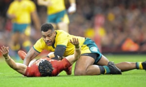 Leigh Halfpenny of Wales is taken out by Samu Kerevi of Australia.