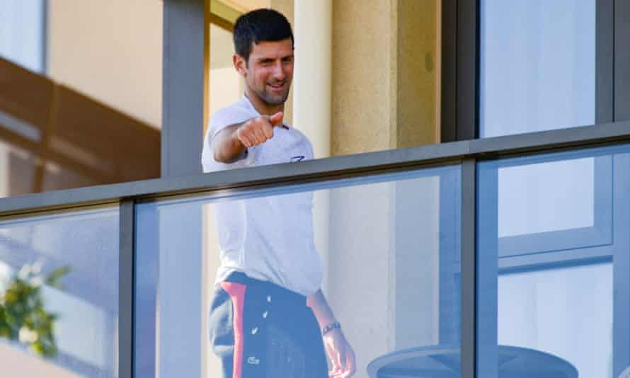Novak Djokovic gestures on Monday from his hotel balcony in Adelaide