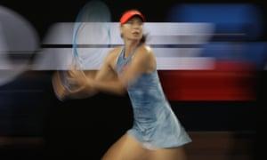 Maria Sharapova looks to make a forehand return to Rebecca Peterson.